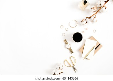 Fashion blog gold style desk with woman accessory collection: golden watches, scissors, coffee cup, notebook and cotton branch on white background. Flat lay. Top view.