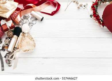fashion blogger concept. luxury essentials jewelry perfume presents flat lay on white rustic wooden table with space for text in soft morning light. modern woman set .  still life