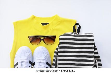 fashion blogger concept. Minimal set of Feminine accessories on white background.