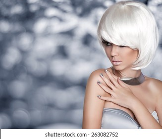 Fashion Blond Girl. Bob Hairstyle. White Short Hair. Beauty Portrait. Woman over Grey bokeh Background. Fringe. Vogue Style. Smoky Eye makeup.