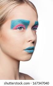 Fashion Blond Model Portrait. Hairstyle. Haircut. Professional Makeup. Creative makeup. Closeup portrait. Studio shot.