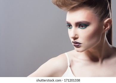 Fashion Blond Model Portrait. Hairstyle. Haircut. Professional Makeup. Unusual creative makeup. Closeup portrait. Studio shot.