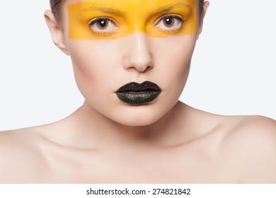 Fashion Blond Model Portrait. Hairstyle. Haircut. Professional Make-up. Unusual creative makeup. Close-up portrait. Studio shot.