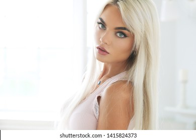 Fashion. Blond woman in close-up