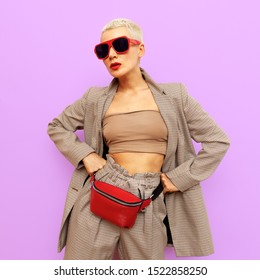 Fashion blonde in a checkered vintage suit and stylish accessories