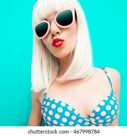 Fashion Blonde on a blue background. Sweet Kiss Girl