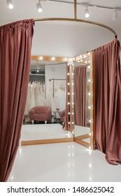 fashion boutique interior, fitting room in the wedding salon.