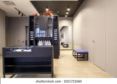 fashion boutique interior, furnished without clothes with empty shop display, clean and new designed interior.