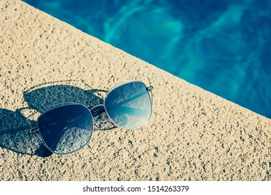 Fashion brand socialite glasses on the edge of the pool