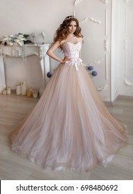 Fashion bride in gorgeous wedding dress studio portrait. Beautiful model girl with bridal makeup and hairstyle in marriage lace dress. Luxury fashion wedding dress on beauty lady