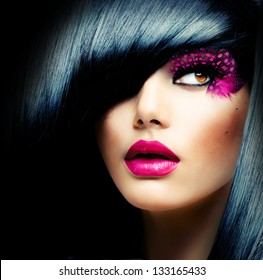 Fashion Brunette Model Portrait. Hairstyle. Haircut. Professional Makeup. False Eyelashes. Purple Make-up