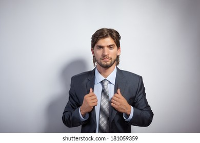 Fashion business man, Handsome serious male model face portrait, young businessman over gray background