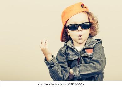 Fashion child. Happy boy model. Stylish little boy in baseball.  Handsome  kid  in the jeans jacket.
