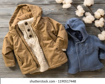 Fashion children's clothing (knit sweaters, hooded canvas jacket. Outfit for little boys. Winter, autumn collection. Organic cotton. Top view, flat lay