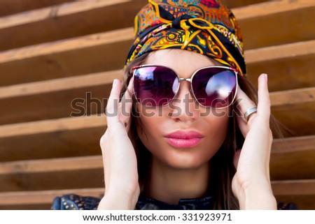 67adbd7905 Fashion close up portrait of beautiful young woman wearing floral bandana  and trendy sunglasses