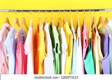 Fashion clothes hanging on wooden hanger