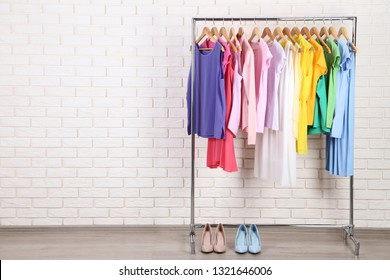 Fashion clothes and high heeled shoes on brick wall background