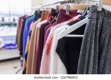 Fashion clothes on clothing rack. Trendy female wear