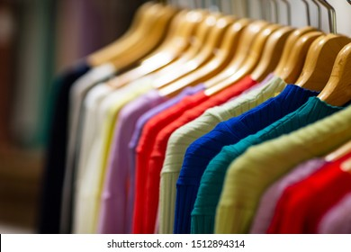 Fashion clothes on clothing rack - bright colorful closet.