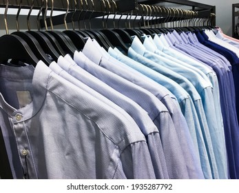 Fashion clothes on clothing rack, Bright colorful cotton shirts on hanger in boutique shop
