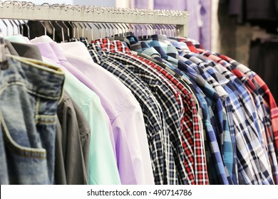 Fashion clothes store. Clothes on hanger in shop