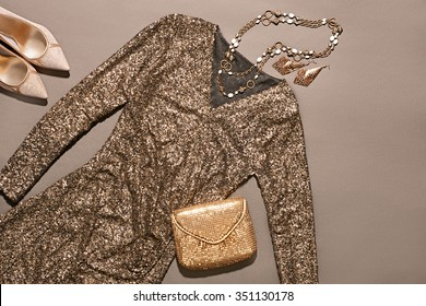 Fashion clothes stylish set, sequins dress and accessories. Glamor Lady Outfit. Trendy gold clutch, necklaces, earrings, Luxury heels.  Unusual evening party style