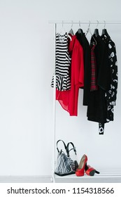 fashion clothing items prepared for a lookbook creation. selection of trendy stylish apparel and accessories on white background.