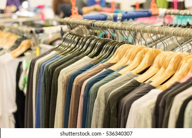 The fashion clothing on hangers at the show in the shop.