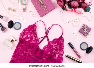 Fashion collection with lace lingerie, accessories, flowers, cosmetics, jewelry on pink background. Womens Day concept