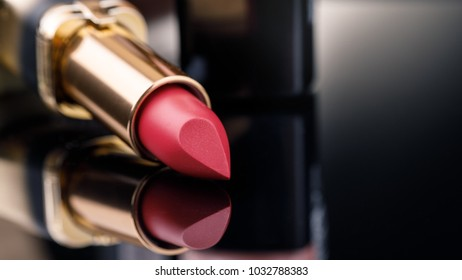 Fashion Colorful Lipsticks over black background with space for text. Lipstick tints palette, Professional Makeup and Beauty. Lipgloss closeup