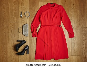 Fashion concept. Red dress, and black shoes with white fur. top view