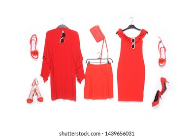 Fashion concept- red sundress clothes on hanging and, shoes ,skirt ,handbag on a white background