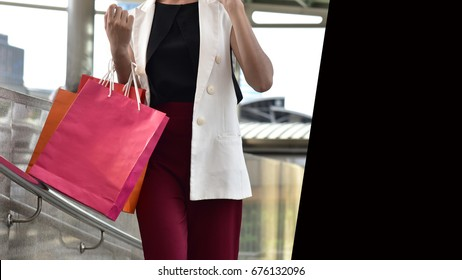 Fashion concept : Shopaholic woman  with back concept background