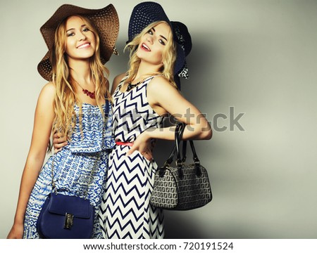 6a129583bef9 fashion concept  two sexy young women in summer fashion dress and straw hats