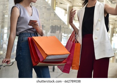 Fashion concept : two women carry the  shopping bags