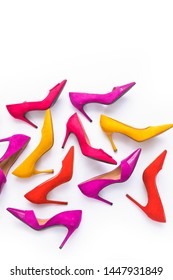 Fashion concept,Pile of different colorful high heels isolated on a white background