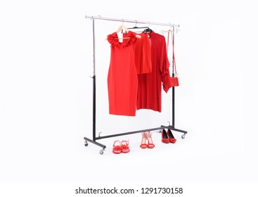 Fashion concept-,red sundress , pants, handbag on hanger and, three shoes on a white background