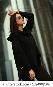Fashion cool girl in sunglasses in urban background