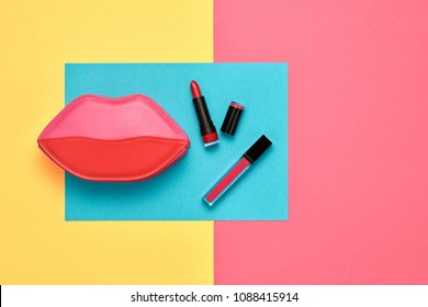 Fashion Cosmetic Makeup Minimal Set. Essentials. Trendy Design Pink Red Clutch Bag. Woman Beauty Accessories. Lipstick, Mascara. Creative. Art Concept Style. Flat lay.