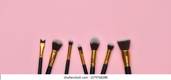 Fashion cosmetic makeup Set. Minimal. Beauty product on pink background. Trendy accessories, cosmetics, brushes art fashionable Flat lay. Creative colorful make up concept, banner