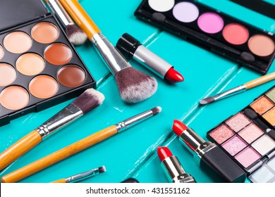 Fashion cosmetic set on a blue wooden background