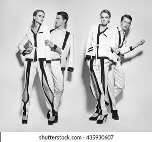 Fashion couple in white suite