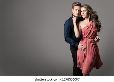Fashion Couple, Young Beautiful Woman in Summer Dress and Elegant Man Studio Beauty Portrait