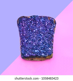 Fashion creative ultra violet toast on pink paper background. Trendy minimal pop art  style. Conceptual idea with bread.