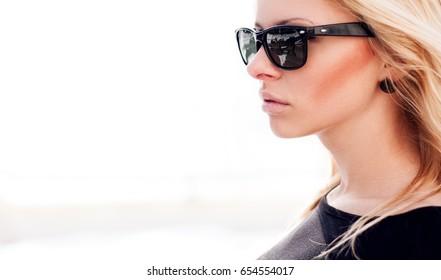 Fashion cute girl in cool wayfarer sunglasses.