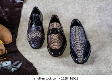 Fashion derby shoes handmade and shoes maker tools (hammer, awl, nails, skein of thread).Leather background.Concept cobbler