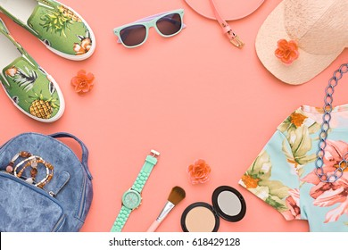 Fashion Design Woman Clothes Accessories Set. Flat lay. Trendy Hipster Dress, Backpack, Sunglasses, Stylish Glamor Gumshoes on Coral. Street fashionable Girl Outfit. Art