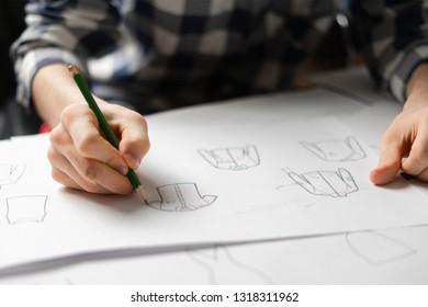 fashion designer draw clothes concept with pencil