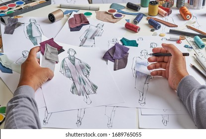 Fashion designer stylish drawings sketches textile fabric material Costume. Designer creative workshop studio.