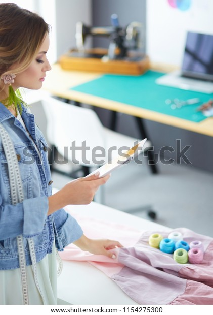 Fashion Designer Woman Working Ipad On Stock Image Download Now